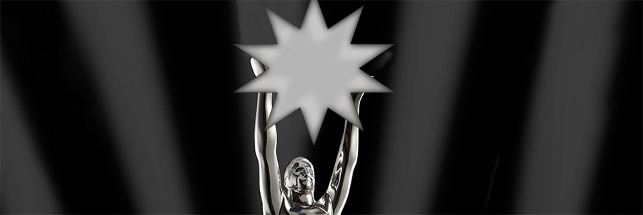 The top of a silver trophy showing a statued figure holding a star aloft