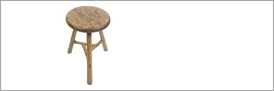 a three-legged stool isolated on a white background
