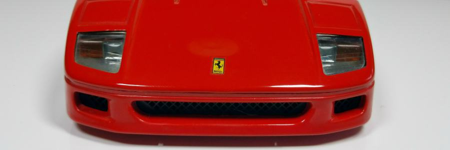 Close up on the front end of a red Ferrari