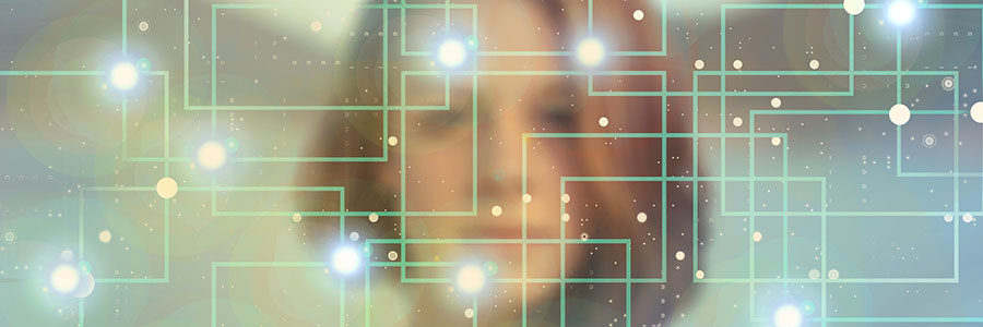 A conceptual image showing a woman's face with a network overlay.