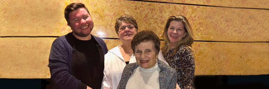 NLM Director Patti Brennan poses with her son, Conor, her mother, and her sister