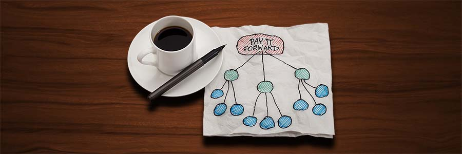 "A napkin drawing labeled ""pay it forward"" conveys the idea of a few people impacting many (single nodes connecting to many more)"